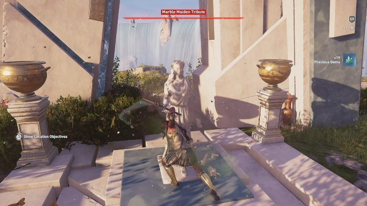 The third Marble Maiden Tribute is located south from the Fortress of the Three Sisters - Deukalions Heritage | Marble Maiden Tribute - Marble Maiden Tribute - Assassins Creed Odyssey Guide