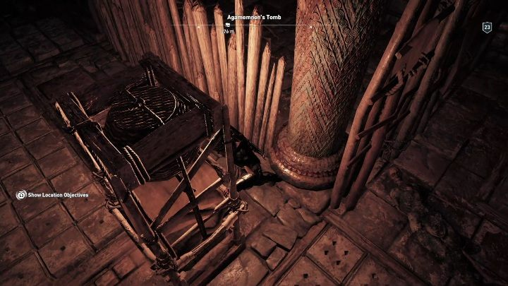 You have to move the shelf towards the wooden stakes blocking the pathway - Argolis - Tombs in Assassins Creed Odyssey Game - Tombs - Assassins Creed Odyssey Guide