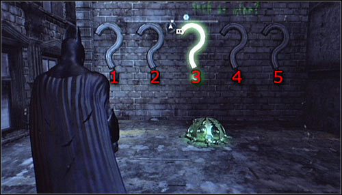 After reaching the area, note the five interactive question marks on the wall - Batman trophies (25-36) | Park Row - Park Row - Batman: Arkham City Game Guide