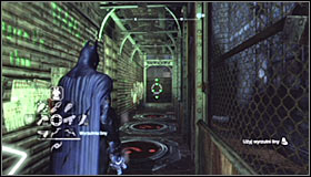 Locate the metal construction adjoining the church, enter it and stand on the green pressure plate #1 - Batman trophies (25-36) | Park Row - Park Row - Batman: Arkham City Game Guide