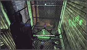 Wait for Batman to land, turn around and use the Batclaw to grab onto the upper ledge #1 - Batman trophies (25-36) | Park Row - Park Row - Batman: Arkham City Game Guide