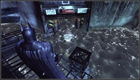 Stand somewhere above the tunnel leading to where the Trophy is hidden #1 - Batman trophies (01-10) | Amusement Mile - Amusement Mile - Batman: Arkham City Game Guide