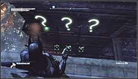 Now use the Grapnel Gun to reach the roof of the nearest building and turn towards the three question marks on the upper level #1 - Batman trophies (11-18) | Amusement Mile - Amusement Mile - Batman: Arkham City Game Guide
