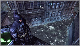 Search for the Trophy cage on one of the lower parts of the roof #1 and afterwards look for the three interactive question marks right beside the water #2 - Batman trophies (11-18) | Amusement Mile - Amusement Mile - Batman: Arkham City Game Guide