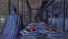 After reaching the destination you should note that the Trophy is inside a big cage #1 and that the access is blocked by red pressure plated that you cannot touch #2 - Batman trophies (19-28) | Amusement Mile - Amusement Mile - Batman: Arkham City Game Guide