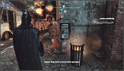 Find the body of an inmate leaned against a telephone booth (screen above) and scan it - Riddles - Industrial District - Batman: Arkham City - Game Guide and Walkthrough