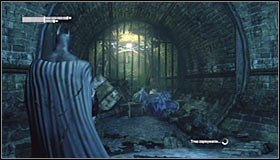 Head south, stopping beside the eastern subway tunnels exit #1 - Batman trophies (01-11) | Subway - Subway - Batman: Arkham City Game Guide