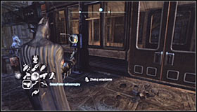 Find the stairs leading onto the upper platform of the monorail #1 - Batman trophies (22-30) | Bowery - Bowery - Batman: Arkham City Game Guide