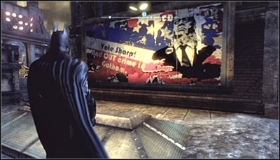 Find the campaign billboard (screen above) and scan it - Riddles | Bowery - Bowery - Batman: Arkham City Game Guide