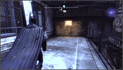 Get onto the balcony adjoining the Arkham City Processing Center (screen above) - Riddles | Bowery - Bowery - Batman: Arkham City Game Guide