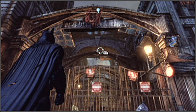 Stand in front of the big gate (screen above) - Riddles | Bowery - Bowery - Batman: Arkham City Game Guide
