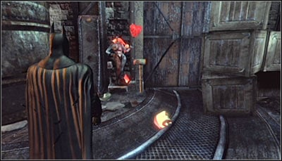 Stand in front of one of Harley heads (no matter whether its already destroyed or not) and scan it together with the hammer beside it (screen above) - Riddles | Steel Mill - Steel Mill - Batman: Arkham City Game Guide