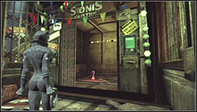 A locked gate guards access to the Trophy - Catwoman trophies | Steel Mill - Steel Mill - Batman: Arkham City Game Guide