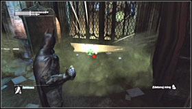 After reaching the destination, you should note that the gate is only partially raised and that there are two proximity mines set below it #1 - Batman trophies (11-23) | Museum - Museum - Batman: Arkham City Game Guide