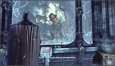 Find the puppet exhibit (screen above), approach it and press the red button to set it into motion - Riddles | Museum - Museum - Batman: Arkham City Game Guide