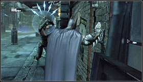 Approach the wall and examine the fragment below the CANCELLED sign #1 - Locate the secret entrance using the video data | Main story - Main story - Batman: Arkham City Game Guide