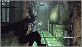 Stand in front of the electrified floor tiles, take out the Line Launcher and shoot it at the wall in the distance #1 - Enigma Conundrum (riddles 16-17) | Side missions - Side missions - Batman: Arkham City Game Guide