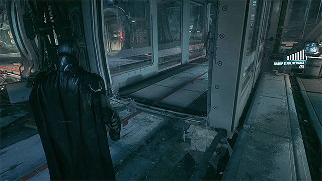 The box will destroy one of the glass walls once you make the airship swing hard enough - Find Scarecrow onboard the second airship | Main story - Main story - Batman: Arkham Knight Game Guide & Walkthrough