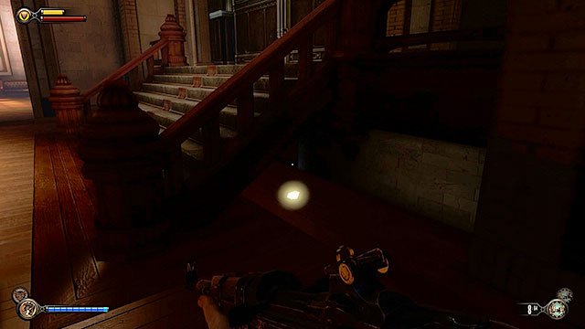 Enter the building, turn left and search the area under the stairs in order to obtain a new lockpick - Find a way into Finkton - Chapter 16 - Worker Induction Center / Finkton Proper - BioShock: Infinite - Game Guide and Walkthrough