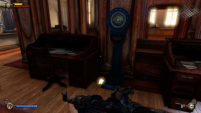 Explore the area behind the main desk to find yet another lockpick hidden between a smaller desk and a scale - Find a way into Finkton - Chapter 16 - Worker Induction Center / Finkton Proper - BioShock: Infinite - Game Guide and Walkthrough