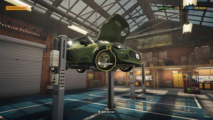 Когда автомобиль поднят, вы можете получить доступ к подвеске спереди и сзади - Car Mechanic Simulator 2021: Замена деталей - Основы - Руководство Car Mechanic Simulator 2021