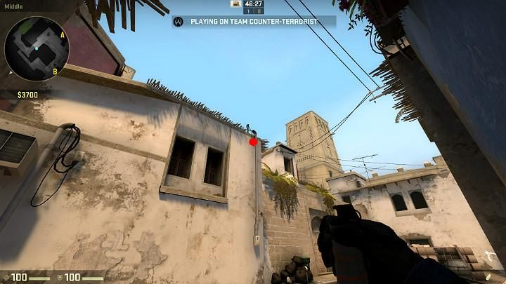Stand with your back to the wall, in the spot shown on the screenshot and aim at the point shown above - Mirage | Tournament maps in CS GO - Tournament Maps in Counter Strike: Global Offensive - CS GO Game Guide