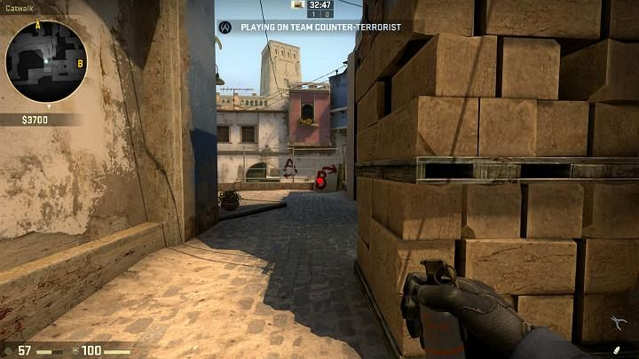 While crossing the center, you can aim at the point shown in the above screenshot, remove the pin and use LMB to throw the grenade while running - Mirage | Tournament maps in CS GO - Tournament Maps in Counter Strike: Global Offensive - CS GO Game Guide