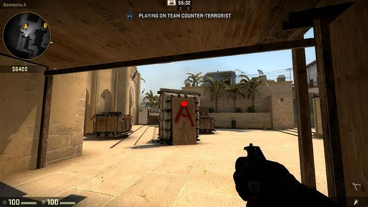 While under the wooden balcony in point A, aim at the point shown in the above screenshot and throw the grenade with LMB - Mirage | Tournament maps in CS GO - Tournament Maps in Counter Strike: Global Offensive - CS GO Game Guide