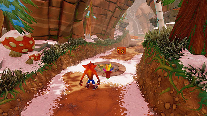Activate the checkpoint and destroy an Aku Aku chest that neighbors two nitro chests - Diggin It | Crash Bandicoot 2 | Levels - Crash Bandicoot 2 - Alpine Warp Room - Crash Bandicoot N. Sane Trilogy Game Guide