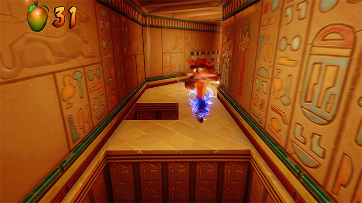 After the level starts, run down the screen and smash four crates, where there is a crate with an extra life - Sphynxinator | Crash Bandicoot 3 | Levels - Crash Bandicoot 3 - Egyptian location - Crash Bandicoot N. Sane Trilogy Game Guide
