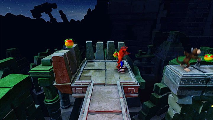 Before you jump onto the ledge on the right, shown in the above screenshot, wait for the monkey there to jump right, because you can easily die after bumping into one - Road to Ruin | Crash Bandicoot 2 | Levels - Crash Bandicoot 2 - Sewer Warp Room - Crash Bandicoot N. Sane Trilogy Game Guide
