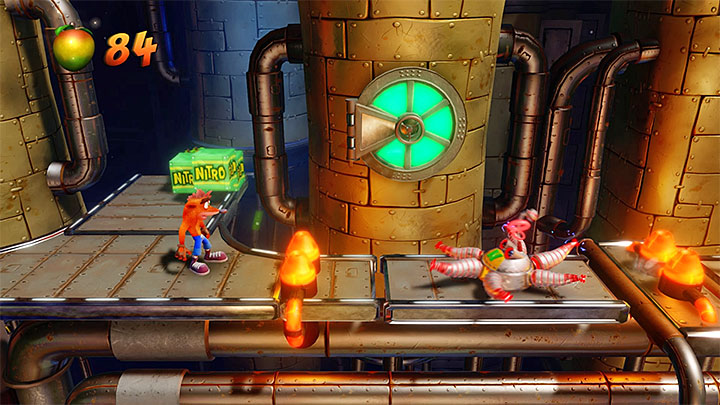 You pass by two new pistons and when you get there you must perform a long jump, preferably after when the left piston is ejected all the way up - Piston It Away | Crash Bandicoot 2 | Levels - Crash Bandicoot 2 - High-Tech Warp Room - Crash Bandicoot N. Sane Trilogy Game Guide