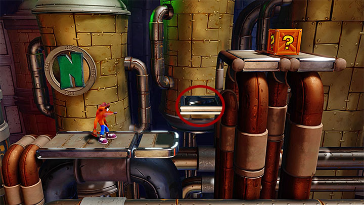 Move into the background and head right - Piston It Away | Crash Bandicoot 2 | Levels - Crash Bandicoot 2 - High-Tech Warp Room - Crash Bandicoot N. Sane Trilogy Game Guide
