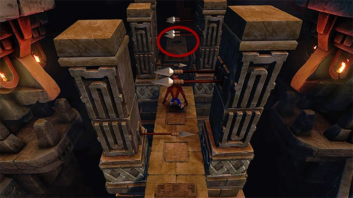 To continue across the main part of ruins, you have to head towards the upper part of the screen and cross another tunnel with stone blocks attempting to crush you (it is a good idea to time well the moments to dash between them - Jaws of Darkness | Cortex Island | Levels - Crash Bandicoot - Cortex Island - Crash Bandicoot N. Sane Trilogy Game Guide