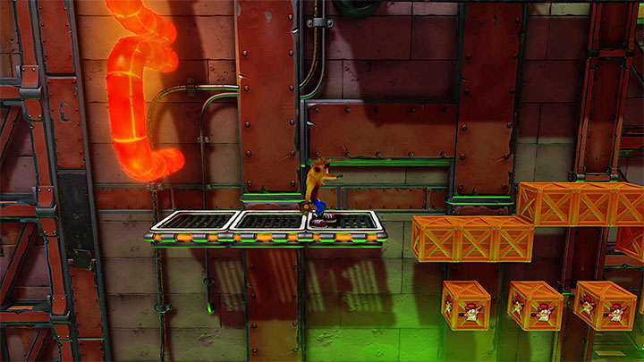 Jump above the first red pipe - Castle Machinery | Cortex Island | Levels - Crash Bandicoot - Cortex Island - Crash Bandicoot N. Sane Trilogy Game Guide