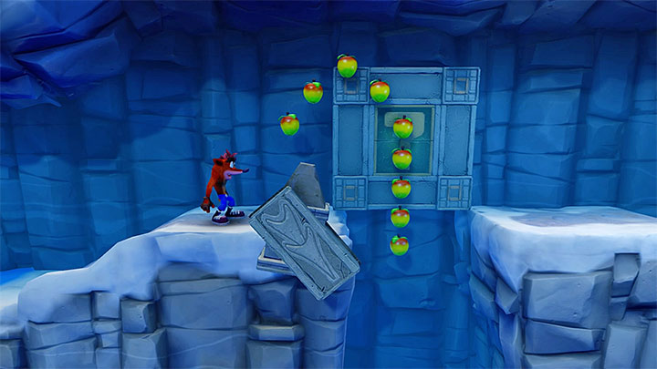 Slide over the ice at the right moment to avid the trap - Snow Biz | Crash Bandicoot 2 | Levels - Crash Bandicoot 2 - Ice Warp Room - Crash Bandicoot N. Sane Trilogy Game Guide