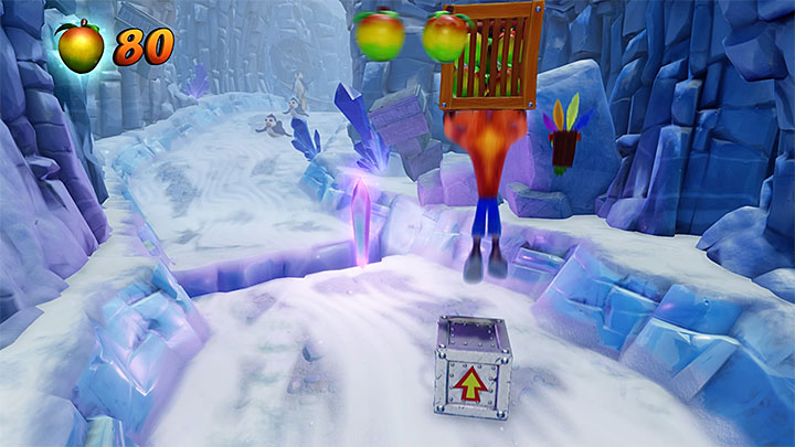 After you return to the main path, start sliding down and eliminate the two seals - Snow Biz | Crash Bandicoot 2 | Levels - Crash Bandicoot 2 - Ice Warp Room - Crash Bandicoot N. Sane Trilogy Game Guide