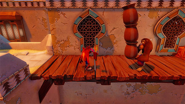Take several jumps to reach the rooftop of the first building - Hang Em High | Crash Bandicoot 3 | Levels - Crash Bandicoot 3 - Arabic location - Crash Bandicoot N. Sane Trilogy Game Guide