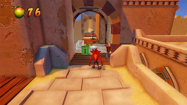 After you have completed the bonus round, bounce off the arrow to grab on to the grate and head deeper into the background - Hang Em High | Crash Bandicoot 3 | Levels - Crash Bandicoot 3 - Arabic location - Crash Bandicoot N. Sane Trilogy Game Guide