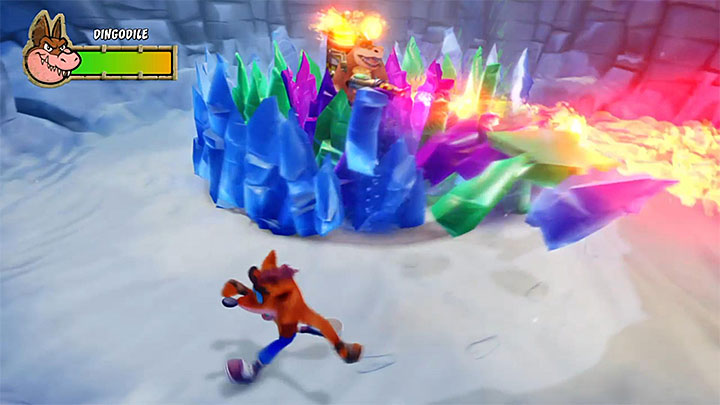 After the bombardment stops, Dingodile will start using his weapon for smashing the crystals around him - Dingodile | Boss fights in Crash Bandicoot 3 Warped - Crash Bandicoot 3 Warped - Crash Bandicoot N. Sane Trilogy Game Guide