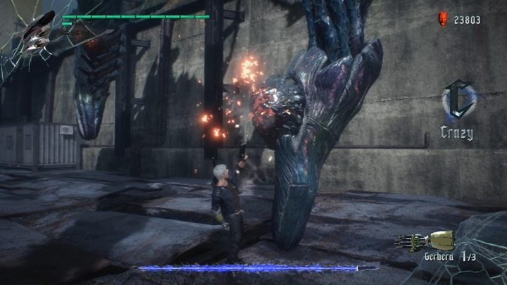 The boss is huge and it has only one weak spot - the red spot on the back - Gilgamesh Boss Fight Guide for DMC5 - Bosses - Devil May Cry 5 Guide