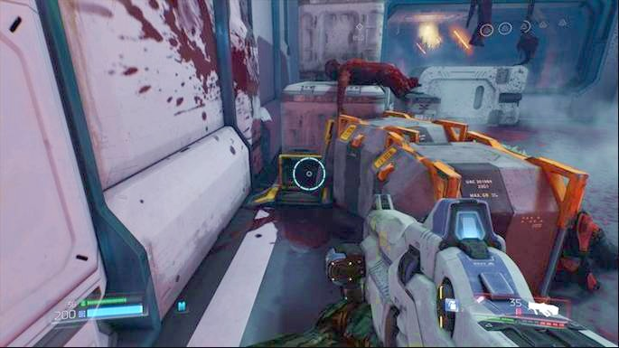 But before you jump down, first use the lever hidden behind the chests on the right - VEGA Central Processing | Walkthrough - Walkthrough - Doom Game Guide & Walkthrough