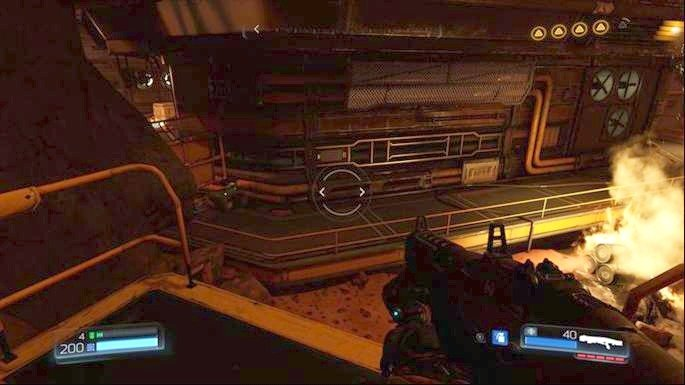 Further path from the combat drone leads through the door below - Destroyed Argent Facility | Secrets - Secrets - Doom Game Guide & Walkthrough
