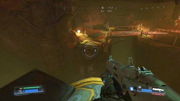 Once you reach the top of the rock, jump to the higher floor of the platform and then to the place on the left - Argent Facility | Walkthrough - Walkthrough - Doom Game Guide & Walkthrough