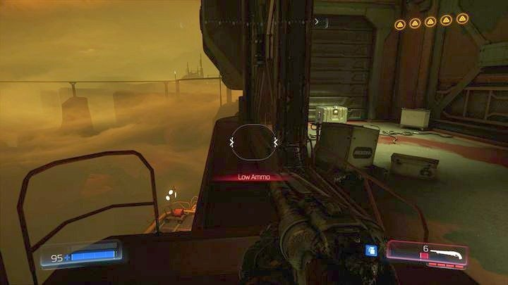 Before you jump below, first go carefully through the edge to the other side (next to the ammunition box) - Argent Facility | Walkthrough - Walkthrough - Doom Game Guide & Walkthrough