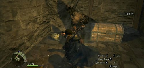 On the other side of the prison, take the lever from the chest - A Fortress Besieged - Act II - Dragons Dogma - Game Guide and Walkthrough