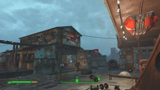 An area, where there are several garages and a gas station - Atom Cats Garage - Southern Boston - Sector 9 - Fallout 4 Game Guide & Walkthrough