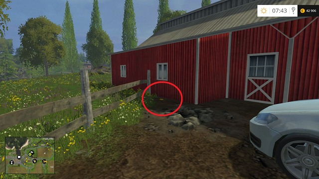 Near the wooden fence, behind the car - Section B - coins 13 - 29 - Gold Coins - Farming Simulator 15 Game Guide