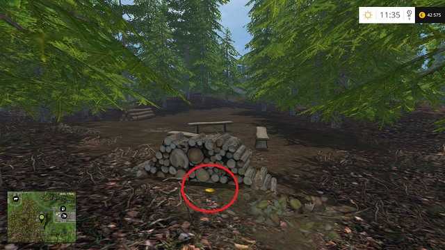 Behind a stack of wood - Section E - coins 55 - 69 - Gold Coins - Farming Simulator 15 Game Guide