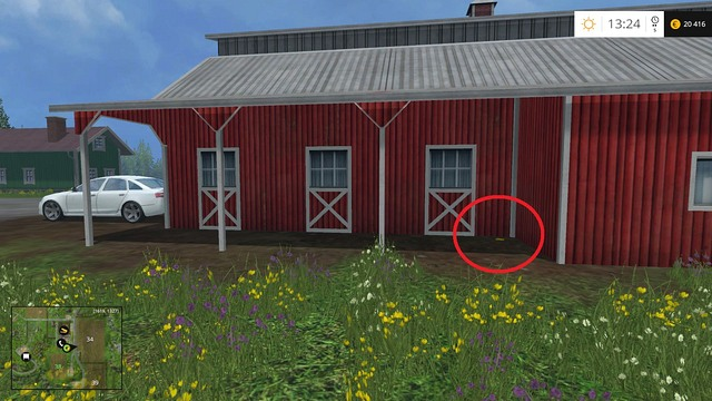 In the corner of a big red building - Section F - coins 70 - 89 - Gold Coins - Farming Simulator 15 Game Guide
